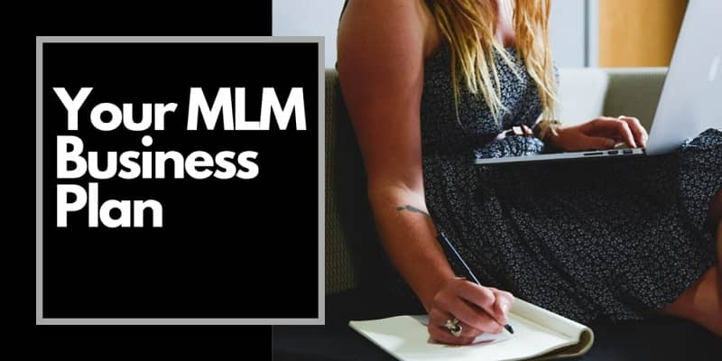 Lady wearing a sun dress writing in her journal with the words MLM business plan next to her right arm.