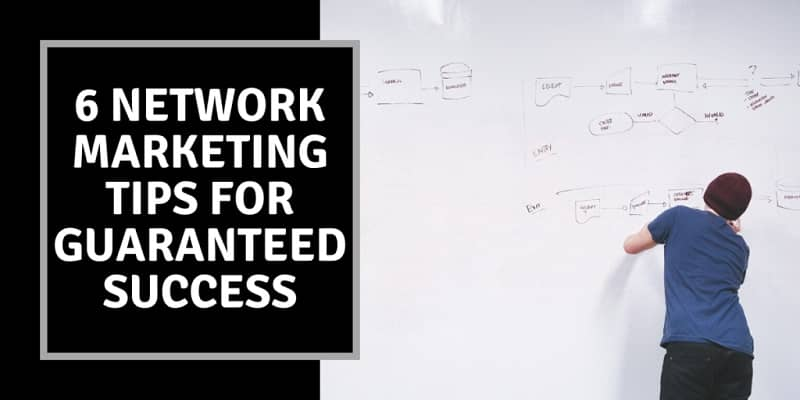 A man writing on a white board, sketching out business plans and next to the board the words network marketing tips for guaranteed success are written.
