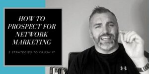 A male wearing a black under armor shirt with this left hand raised up pinching his fingers together to make a point. The tile of the photo is: How to prospect for network marketing.