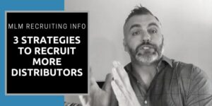 Robb wearing a black and grey dress shirt, his beard is grey and his hair is parted to the right. He is doing a video training and providing MLM recruiting info, the title of the picture reads the same.