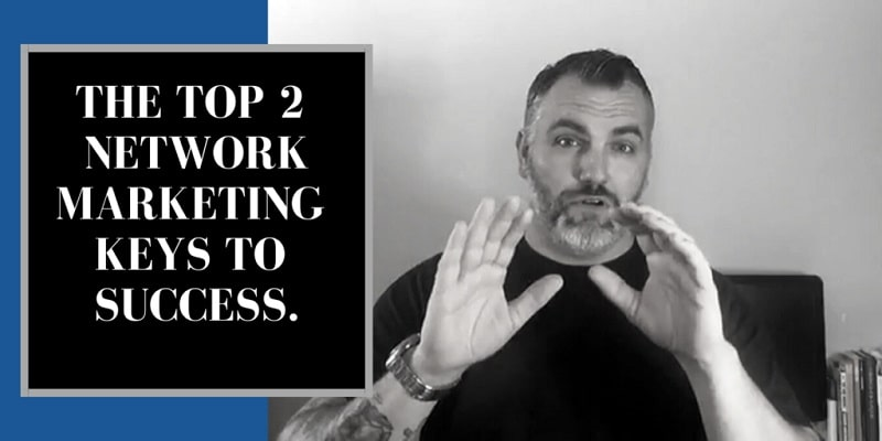 A tanned man with tattoos on his right arm, wearing a big silver watch and a black shirt. He has a beard and slicked hair. The title on the photo reads: Network Marketing Keys to Success.