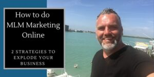 """Robb in on a boat dock on the intercoastal water way in Indian Rocks Florida, standing in front of some boats with the following heading written on the photo: How to do MLM Marketing Online""""."""