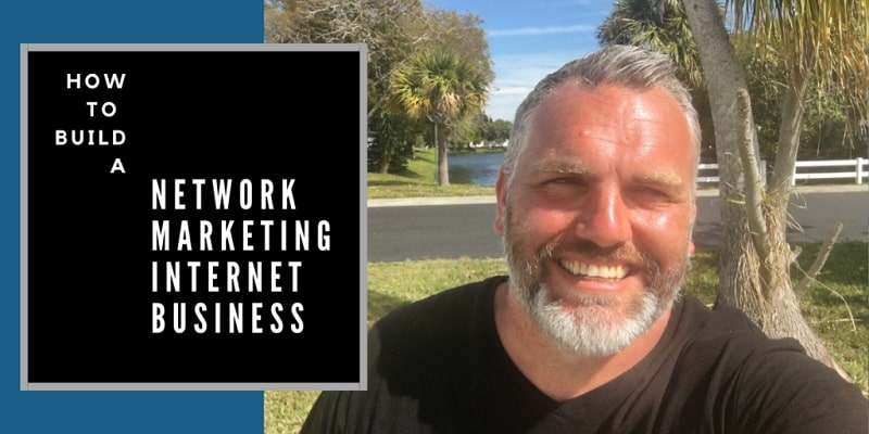 Robb Corbett in front of a palm tree in Seminole Florida with a lake behind him. The words network network marketing internet business are written on the photo also.