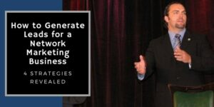 Mr. Corbett on stage dressed in a suit training on how to generate leads for a network marketing business.