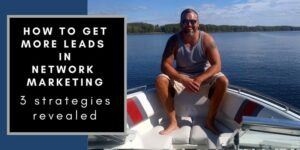 """Robb sitting on the bow of his boat on the saint john river, trees can be seen in the back ground, the words """"how to get more leads in network marketing"""" are typed in text to his right."""