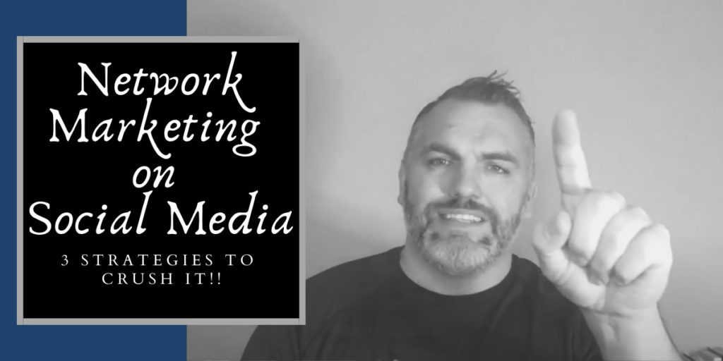 Robb Corbett with left hand up with words network marketing on social media