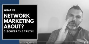 Robb Corbett in his office with words on side of blog that say what is network marketing about