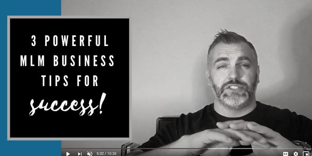Robb Corbett in his office hands raised with writing on photo saying 3 powerful mlm business tips for success