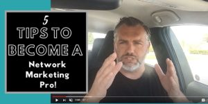 Robb corbett in his car training on how to become a network marketing pro