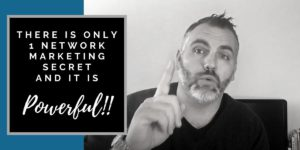 Robb Corbett with 1 finger raised and writing that says there is only 1 network marketing secret and it is powerful