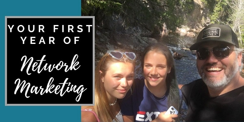 Robb Corbett out hiking with his daughters with a river behind them and the words your first year of network marketing next to them in photo
