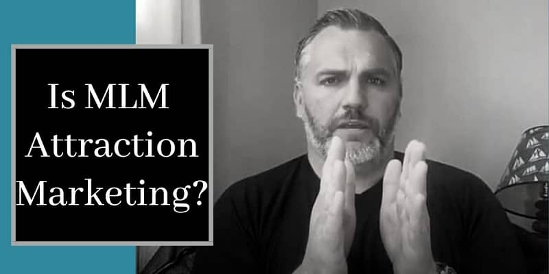 Robb Corbett sitting down with hands chest height and words on picture that say is mlm attraction marketing