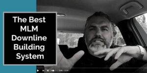 A photo of Robb Corbett in his car training on a MLM Downline Building System