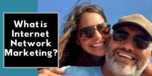 Robb Corbett with Girl Friend with blue sky behind and writing on picture that says what is internet network marketing