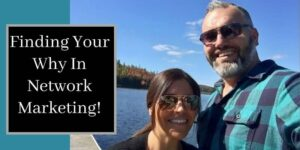 Robb Corbett and his girl friend on a boat dock with fall colored leaved and water behind them and the words finding your why in network marketing written on the photo.