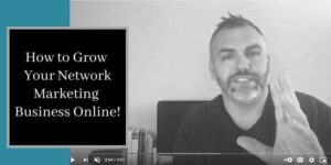 a photo of a video by robb corbett where he is in his office in front of his computer wearing a black shirt and the words how to grow your network marketing business online written in text on the side of the picture