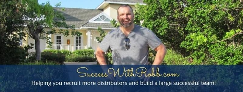 Robb Corbett network marketing trainer in front of yellow home