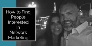Guy and girl out front of the MGM in Las Vegas at night. Statue of liberty from new york new york is in back ground and the words how to find people interested in network marketing are written on the photo
