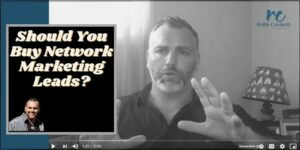A black and white photo of a man sitting on a couch wearing a button up shirt. The following text is written on the photo: Buy network marketing leads.