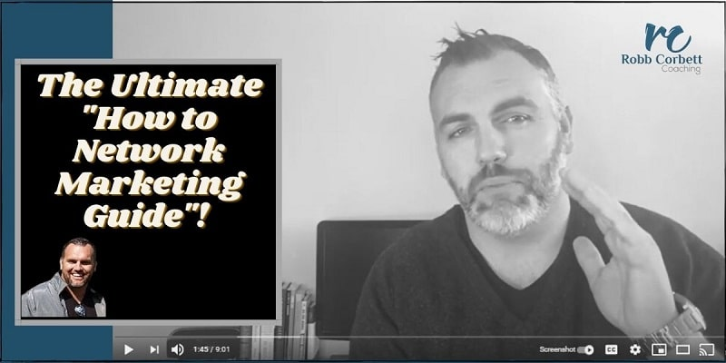 A tall guy with a grey beard facing the camera with his back to a computer monitor.  The tile of the photo is to the left and says the ultimate how to network marketing guide.