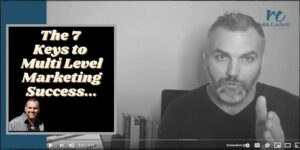 Robb Corbett sitting at his desk speaking into the camera, the title of the phone is the 7 Keys to Multi Level Marketing Success.