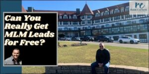Robb sitting in front of a castle on a rock wall. Can you really get mlm leads for free